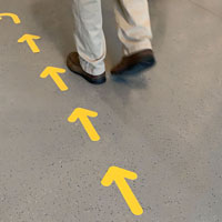 Yellow arrow signs for floor