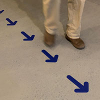 Blue arrow markers for floor