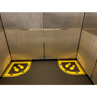 One person per corner of elevator signs