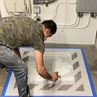 Painting an electical panel warning stencil