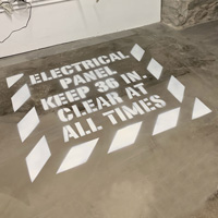 """Keep back 36"""" from electrical panel sign made with a stencil"""
