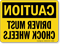 Caution Driver Must Chock Wheels Mirrored Image Sign