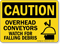 Overhead Conveyors Watch For Flying Debris Sign